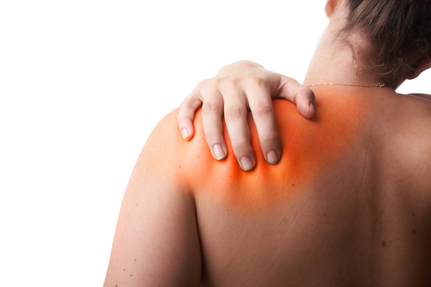 Young woman with frozen shoulder pain. She is holding her schoulder. Over white background. The hurting area was saturated in red to symbolize the pain.